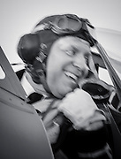 WWII Royal Air Force Pilot re-enactor in the cockpit of a WWII era British Royal Navy Seafire F. XV.  Created during AirVenture in Oshkosh, Wisconsin.  <br />