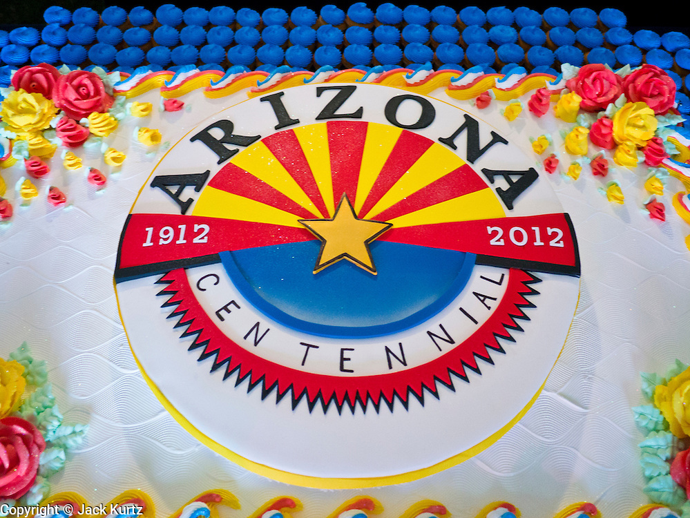 14 FEBRUARY 2012 - PHOENIX, AZ:  The Arizona centennial birthday cake at the State Capitol in Phoenix, Feb 14. Arizona's statehood day is February 14 and this year Arizona marked 100 years of statehood. It was the last state in the 48 contiguous United States.    PHOTO BY JACK KURTZ