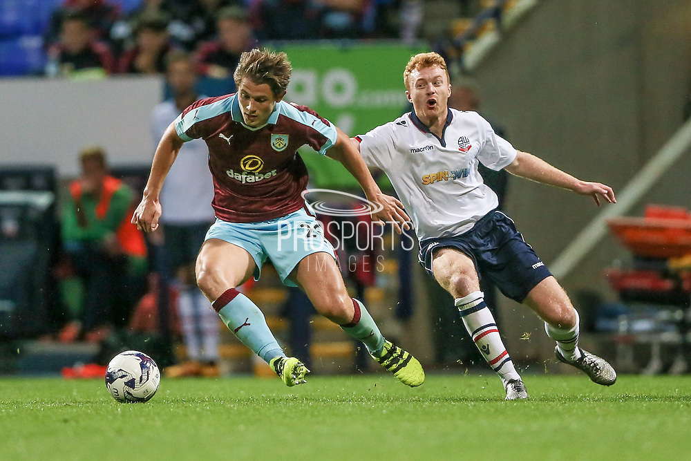 James Tarkowski (Burnley) turns with the ball in his penalty box and runs it out of defence during the Pre-Season Friendly match between Bolton Wanderers and Burnley at the Macron Stadium, Bolton, England on 26 July 2016. Photo by Mark P Doherty.