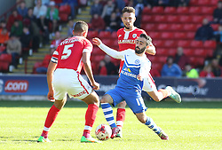 Peterborough United's Erhun Oztumer takes on Barnsley's Lewin Nyatanga - Photo mandatory by-line: Joe Dent/JMP - Mobile: 07966 386802 - 18/04/2015 - SPORT - Football - Barnsley - Oakwell - Barnsley v Peterborough United - Sky Bet League One