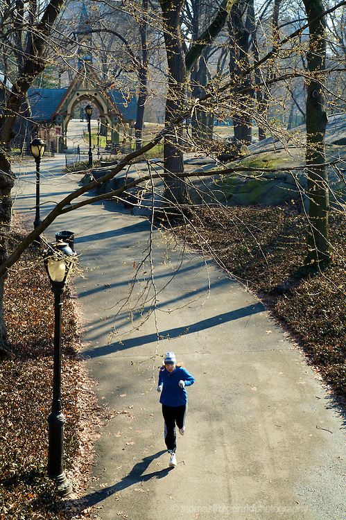 24th JANUARY 2006, New York City, USA: A Woman Keeping Fit by Jogging alone through Central Park during a fresh and Cold Winter Day.