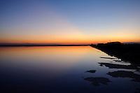 Il complesso produttivo delle saline è situato nel comune italiano di Margherita di Savoia (nome dato dagli abitanti in onore alla regina d'Italia che molto si adoperò nei confronti dei salinieri) nella provincia di Barletta-Andria-Trani in Puglia. Sono le più grandi d'Europa e le seconde nel mondo, in grado di produrre circa la metà del sale marino nazionale (500.000 di tonnellate annue).All'interno dei suoi bacini si sono insediate popolazioni di uccelli migratori e non, divenuti stanziali quali il fenicottero rosa, airone cenerino, garzetta, avocetta, cavaliere d'Italia, chiurlo, chiurlotello, fischione, volpoca..Scorcio di un bacino al tramonto con formazioni di sale in primo piano.