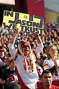 """LANDOVER, MD - NOVEMBER 26:  A Washington Redskins fan holds up a sign stating """"in Jason we trust"""" during the game against the Carolina Panthers at FedExField on November 26, 2006 in Landover, Maryland. Redskins quarterback Jason Campbell #17 threw for two touchdowns in his first win as a starting QB. The Redskins defeated the Panthers 17-13. ©Paul Anthony Spinelli *** Local Caption *** Jason Campbell"""