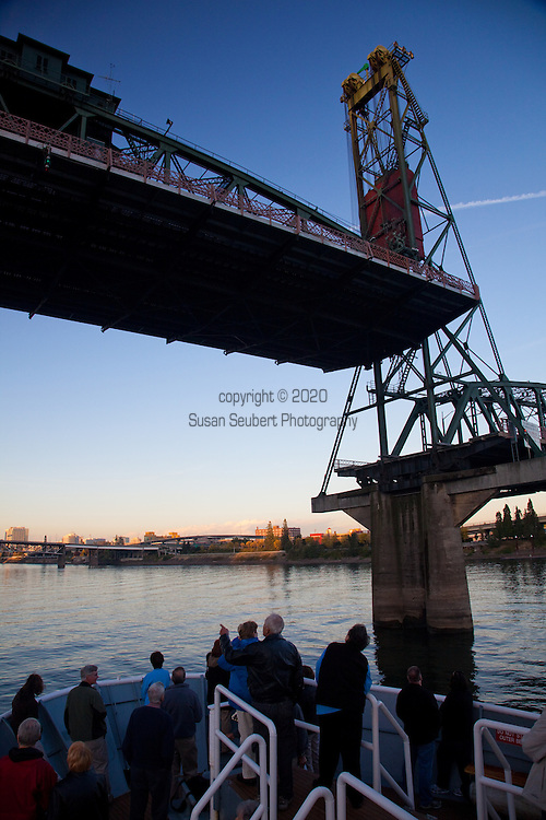 National Geographic Sea Lion's trip departing from Portland, Oregon, through the bridges and heading out towards Astoria, Oregon. The bottom of the Hawthorne Bridge lifts to allow the Sea Lion to depart the port in downtown Portland.
