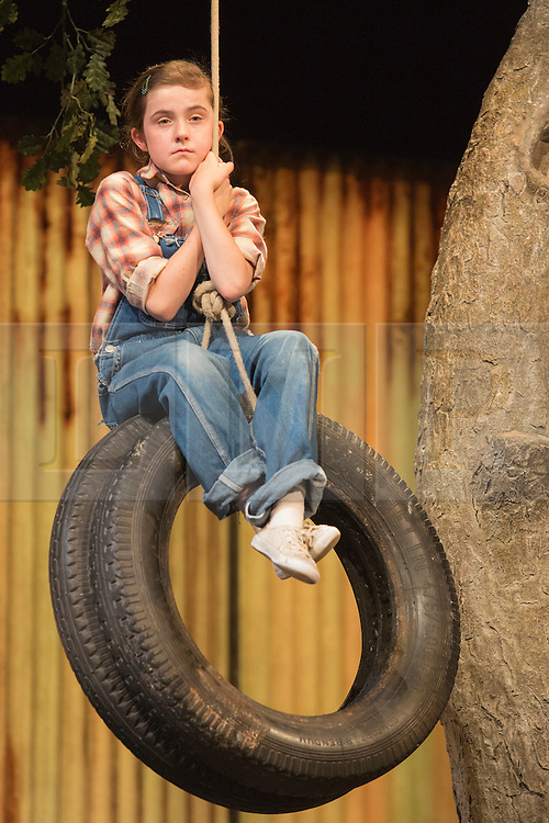 "© Licensed to London News Pictures. 25/06/2015. London, UK. Ava Potter as Scout. Photocall for ""To Kill a Mockingbird"" at the Barbican Theatre with Robert Shean Leonard as Atticus Finch and Ava Potter as Scout.  The Regent's Park Open Air Theatre production directed by Timothy Sheader will be at the Barbican from 24 June to 25 July 2015. Adapted for the stage by Christopher Sergel based on the novel by Harper Lee. Photo credit : Bettina Strenske/LNP"