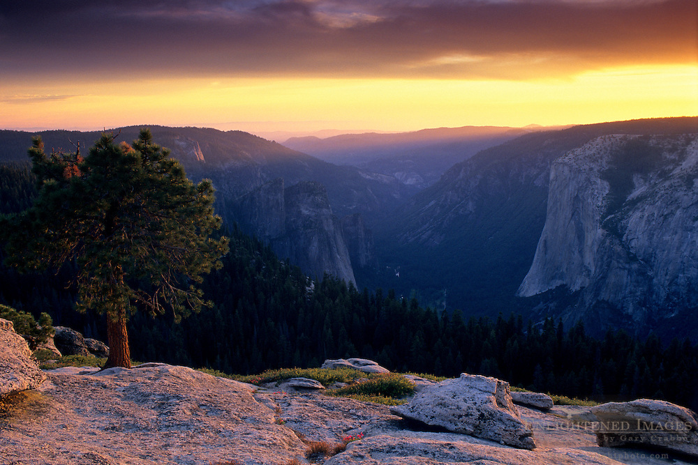 Looking west at sunset over Yosemite valley from atop Sentinel Dome, Yosemite National Park, CALIFORNIA