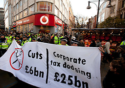 © Licensed to London News Pictures. 17/12/2011. LONDON, UK. UK Uncut protesters hold a banner outside Vodafone's Oxford Street store in London today (17/12/11). Photo credit: Matt Cetti-Roberts/LNP