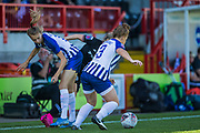 Erin Cuthbert (Chelsea) sandwiched between Ellie Brazil (Brighton) & Fliss Gibbons (Brighton) during the FA Women's Super League match between Brighton and Hove Albion Women and Chelsea at The People's Pension Stadium, Crawley, England on 15 September 2019.
