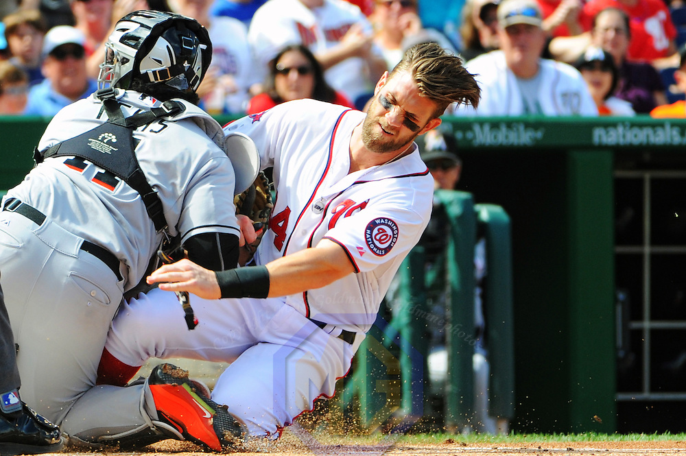 Washington Nationals right fielder Bryce Harper (34) slides safely home as Miami Marlins catcher Tomas Telis (11) blocks the plate in the first inning at Nationals Park in Washington, D.C. on September 20, 2015.  (Photograph by Mark Goldman - Goldminephotos)