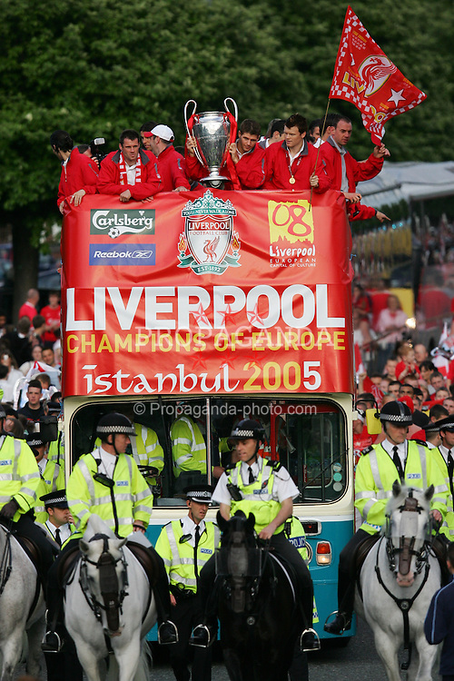 LIVERPOOL, ENGLAND - THURSDAY, MAY 26th, 2005: Liverpool players Jamie Carragher, Steven Gerrard and John Arne Riise parade the European Champions Cup on on open-top bus tour of Liverpool in front of 500,000 fans after beating AC Milan in the UEFA Champions League Final at the Ataturk Olympic Stadium, Istanbul. (Pic by David Rawcliffe/Propaganda)