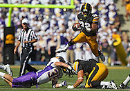 September 15 2012: Iowa Hawkeyes running back Damon Bullock (32) jumps over Northern Iowa Panthers linebacker Jordan Gacke (35) and Iowa Hawkeyes tight end C.J. Fiedorowicz (86) during the second quarter of the NCAA football game between the Northern Iowa Panthers and the Iowa Hawkeyes at Kinnick Stadium in Iowa City, Iowa on Saturday September 15, 2012. Iowa defeated Northern Iowa 27-16.