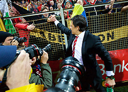 ZENICA, BOSNIA & HERZEGOVINA - Saturday, October 10, 2015: Wales' manager Chris Coleman celebrates with supporters after qualifying for the Euro 2016 finals despite a 2-0 defeat to Bosnia and Herzegovina during the UEFA Euro 2016 qualifying match at Stadion Bilino Polje. (Pic by David Rawcliffe/Propaganda)
