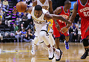 April 21, 2012; Indianapolis, IN, USA; Indiana Pacers shooting guard Paul George (24) loses control of the ball as he drives to the lane against the Philadelphia 76ers at Bankers Life Fieldhouse. Philadelphia defeated Indiana 109-106. Mandatory credit: Michael Hickey-US PRESSWIRE