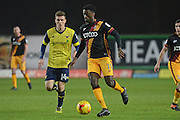 Bradford City striker Jordy Hiwula (11) escapes from Oxford United midfielder Joshua Ruffels (14) 0-0 during the EFL Trophy match between Oxford United and Bradford City at the Kassam Stadium, Oxford, England on 31 January 2017. Photo by Alan Franklin.