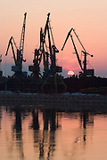 Cranes along the Danube at sunrise...M.S. Johann Strauss, a brand new four star+ river cruiser operated by Austrian River Cruises, and chartered by Club 50 (a travel agency especially for seniors aged 50 and up) undertook an epic 3-week journey (May 21 to June 10, 2004) all the way from Amsterdam to the Black Sea?along Rhine, Main and Danube?, presumably the first passenger vessel ever to have done so. This is one of the images recorded during this historic voyage.