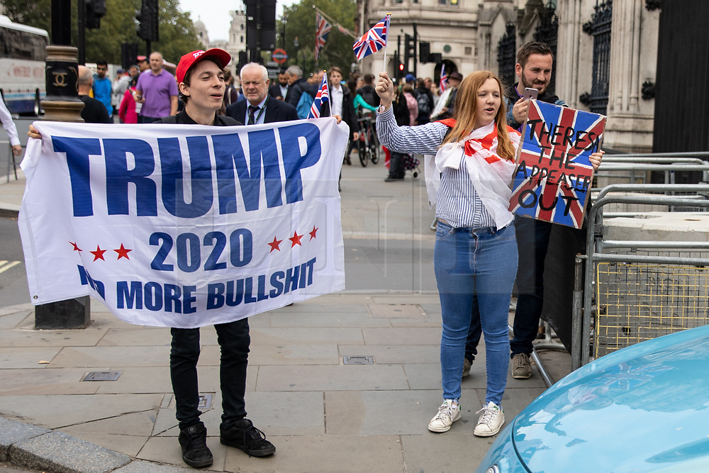 © Licensed to London News Pictures. 05/09/2018. London, UK. NOTE: FILE PHOTO. Max Hammet-Millay (left) and James Goddard (right) pictured heckling a car leaving the Houses of Parliament, during a Brexit demonstration in September. The pair have been accused of being part of the group calling Conservative MP Anna Soubry a 'Nazi' on Monday this week. [ORIGINAL CAPTION: Anti-Brexit demonstrators and some far-right sympathisers campaign outside the Houses of Parliament, calling for Britain's immediate exit from the EU, and the re-instating of former Foreign Secretary Boris Johnson.] Photo credit : Tom Nicholson/LNP