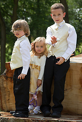 Pageboys and bridesmaid at wedding reception.