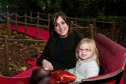 © Licensed to London News Pictures. 13/11/2013. London, UK. ZSL London Zoo. Actress Natalie Cassidy and her three year old daughter, Eliza, meet the reindeer and are the first to meet Santa to start off the Meet Santa Experience. Natalie is about to make her return to Eastenders. Photo credit : Simon Ford/LNP