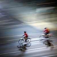 Panning shot of cyclists by night, Berlin, Germany