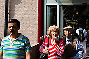 People at the Keukenhof tulip and flower show in Lisse, Holland - Netherlands. They don't look happy. The man in the hat has a rather panicked expression, while the lady has adopted a pensive pose. Editorial Use only.