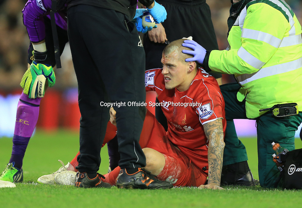 21 December 2014 - Barclays Premier League - Liverpool v Arsenal - Martin Skrtel of Liverpool is treated after having his head stood on by Olivier Giroud of Arsenal - Photo: Marc Atkins / Offside.