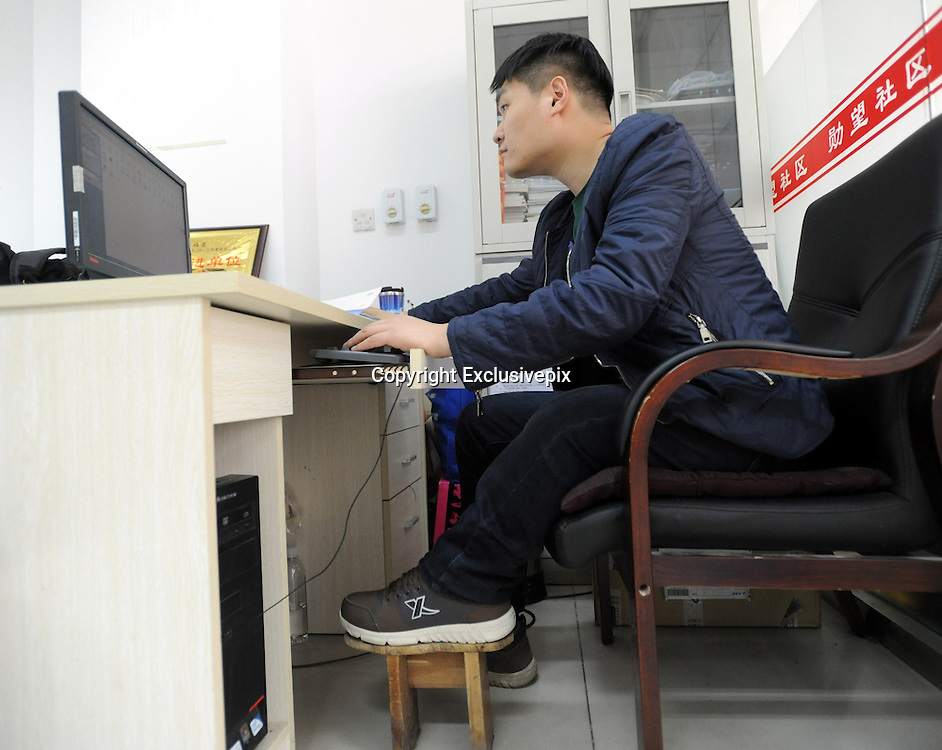 SHENYANG, CHINA - MARCH 28: (CHINA OUT)<br /> <br /> Man Has One Leg Shorter 23 CM Than The Other<br /> <br /> 27-year-old Zhao Qiang sits in front of a computer on March 28, 2014 in Shenyang, Liaoning Province of China Zhao had multiple chondroma when he was 2-year-old which made his left leg grow slower than the right one,  Zhao got an idea to wear a wooden bench on his left leg to keep balance. Hear has been wearing the wooden bench for 14 years. <br /> &copy;Exclusivepix