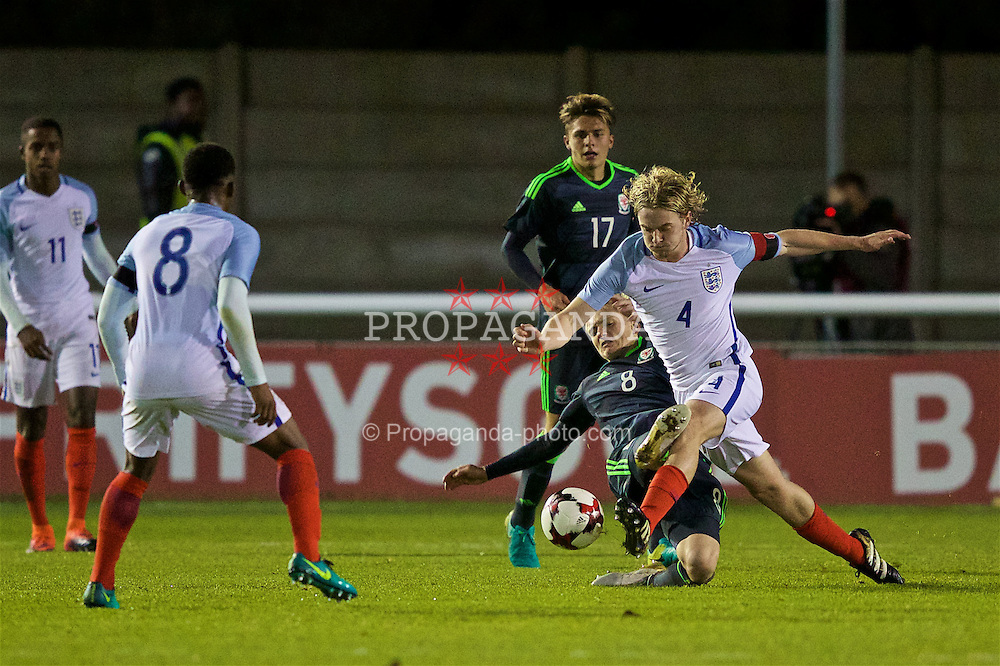 BANGOR, WALES - Saturday, November 12, 2016: Wales' Matthew Smith in action against England's captain Tom Davies during the UEFA European Under-19 Championship Qualifying Round Group 6 match at the Nantporth Stadium. (Pic by Gavin Trafford/Propaganda)