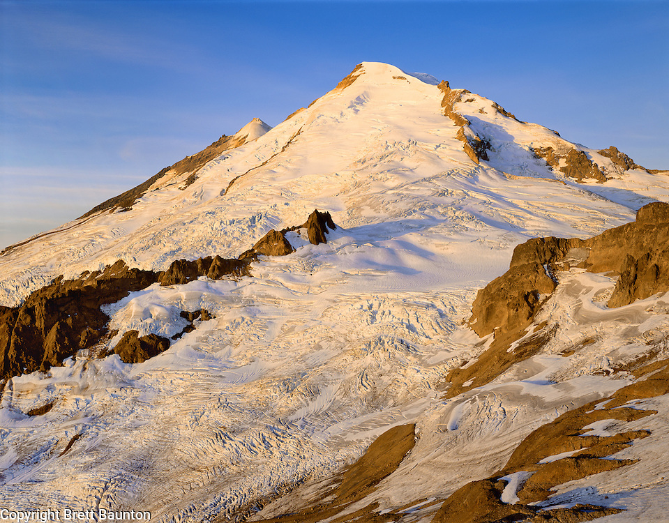 Mt. Baker, WA, USA.Dormant Volcano, 10,778Ft / 3285m..Mt. Baker Wilderness Area..Sunrise Alpenglow from Portal Peaks..4x5 Transparency.Brett Baunton.