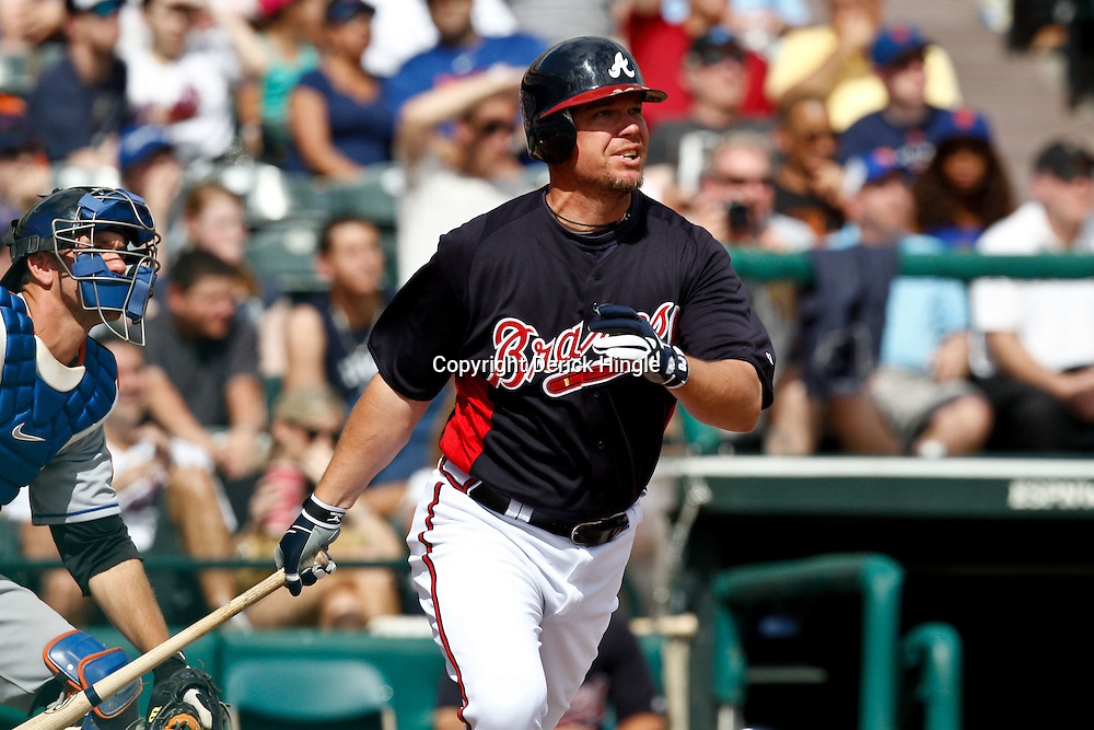 March 5, 2011; Lake Buena Vista, FL, USA; Atlanta Braves third baseman Chipper Jones (10) hits a homerun during a spring training exhibition game against the New York Mets at Disney Wide World of Sports complex.  Mandatory Credit: Derick E. Hingle