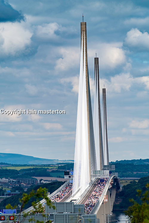 Members of the public walk across new Queensferry Crossing Bridge before it is officially opened. Scotland, United Kingdom.