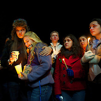 Stratford High School students Ally Kutcher and Caitlyn Larocque embrace during a prayer vigil in Stratford, CT, the day after a mass shooting of 20 children and 7 adults at Sandy Hook Elementary School, in Sandy Hook, CT, on December 14, 2012.