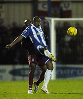 Photo: Olly Greenwood.<br />Colchester United v Stoke City. Coca Cola Championship. 16/12/2006. Colchester's Chris Iweleuno and Stoke's Michael Duberry