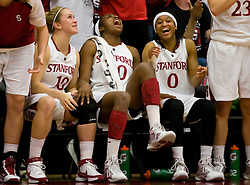 February 20, 2010; Stanford, CA, USA;  Stanford Cardinal guard JJ Hones (10) and forward Nnemkadi Ogwumike (30) and guard Melanie Murphy (0) share a laugh on the bench during the second half against the Oregon St. Beavers at Maples Pavilion.  Stanford defeated Oregon State 82-48.