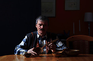 Mats Steinfjell, last of the few Sami still fluent in the southern dialect, holds wooden spoon from great-great grandfather dated 1861.