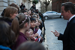 Ukrainian leaders meet with David Cameron. Prime Minister David Cameron chat with a group of school children as he arrives at 10 Downing Street for a diplomatic meeting with Ukranian leaders.10 Downing Street, London, United Kingdom. Wednesday, 26th March 2014. Picture by Daniel Leal-Olivas / i-Images