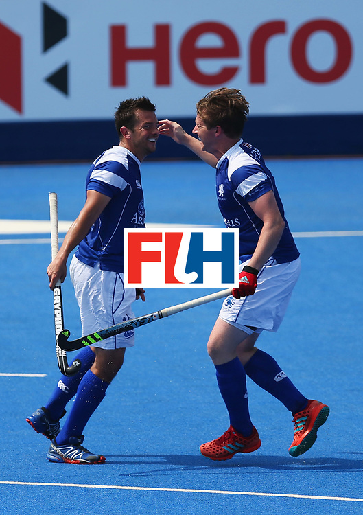 LONDON, ENGLAND - JUNE 20:  Willie Marshall of Scotland (L) celebrates with Alan Forsyth as he scores their first goal during the Pool B match between Scotland and Canada on day six of the Hero Hockey World League Semi-Final at Lee Valley Hockey and Tennis Centre on June 20, 2017 in London, England.  (Photo by Alex Morton/Getty Images)