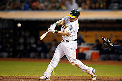 OAKLAND, CA - SEPTEMBER 09:  Bruce Maxwell #63 of the Oakland Athletics hits an RBI double against the Seattle Mariners during the seventh inning at the Oakland Coliseum on September 9, 2016 in Oakland, California. The Seattle Mariners defeated the Oakland Athletics 3-2. (Photo by Jason O. Watson/Getty Images) *** Local Caption *** Bruce Maxwell