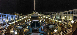 An iPhone6 panoramic image from the ship at night, Abu Dhabi. Images from the MSC Musica cruise to the Persian Gulf, visiting Abu Dhabi, Khor al Fakkan, Khasab, Muscat, and Dubai, traveling from 13/12/2015 to 20/12/2015.