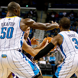 December 15, 2010; Sacramento Kings point guard Beno Udrih (19) is defended by New Orleans Hornets player point guard Chris Paul (3), center Emeka Okafor (50) and shooting guard Willie Green (33) during the second half at the New Orleans Arena. The Hornets defeated the Kings 94-91. Mandatory Credit: Derick E. Hingle