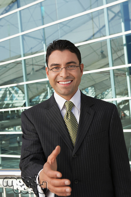 Businessman extending hand for handshake, portrait