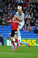 Hull city's Paul McShane (15) climbs over Cardiff's Craig Noone to win a header. NPower championship, Cardiff city v Hull city at the Cardiff city stadium in Cardiff, South Wales on Saturday 10th November 2012.  pic by Andrew Orchard, Andrew Orchard sports photography,
