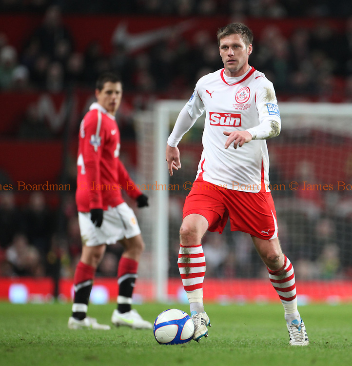 JAMES BOARDMAN / 07967642437.Crawley Town's Dannie Bulman on the ball during the Fifth round FA Cup match between Manchester United and Crawley Town at Old Trafford in Manchester February 19, 2011.