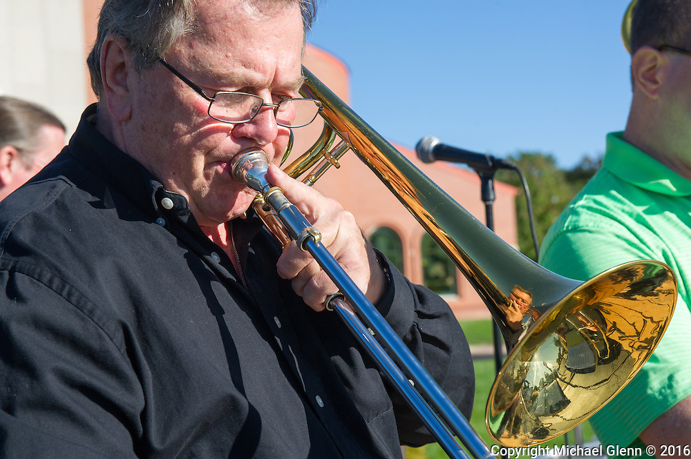 15 Oct. 2016 Forked River USA / Brass players faces are reflected in the horns as The Joe Dalton band performs at the St Pius X celebrates it's 10th year in their new church with a festival open to all  /  Michael Glenn  / Glenn Images