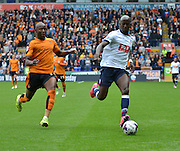Wellington Silva watched a ball out away from Benik Afobe during the Sky Bet Championship match between Bolton Wanderers and Wolverhampton Wanderers at the Macron Stadium, Bolton, England on 12 September 2015. Photo by Mark Pollitt.