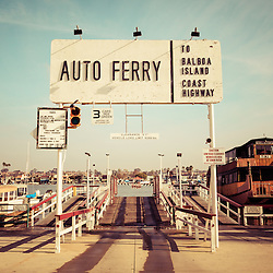 Balboa Island Ferry Newport Beach vintage picture.  The photo has a 1950s or 1960s nostalgic tone applied. Located in Newport Beach California, The Balboa Island Ferry has been operating since 1919 and carries people and cars from Balboa Peninsula to Balboa Island across Newport Harbor (Newport Bay).