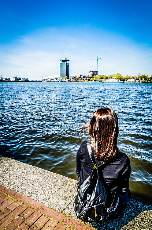 In the distance, the EYE Film Museum and the A'dam Toren sit on the north shore of the IJ.