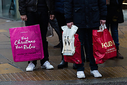 © Licensed to London News Pictures. 13/12/2015. London, UK. Christmas shoppers with shopping bags in Oxford Street in London on the penultimate shopping weekend before Christmas.  Photo credit : Vickie Flores/LNP