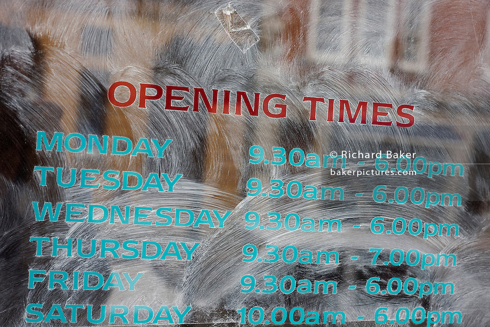 White emulsion paint has been smeared over the opening times in the window of a former Christian CD, books and software shop in central London, a victim of the UK recession.