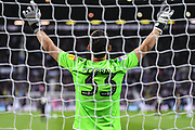 Reading goalkeeper Rafael Barbosa (33) holds his hands in the air, praying during the EFL Sky Bet Championship match between West Bromwich Albion and Reading at The Hawthorns, West Bromwich, England on 21 August 2019.