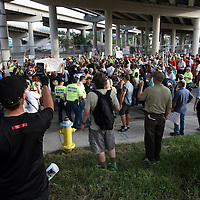 Parade walkers congregate under the highway during the Republican National Convention in Tampa, Fla. on Wednesday, August 29, 2012. (AP Photo/Alex Menendez)